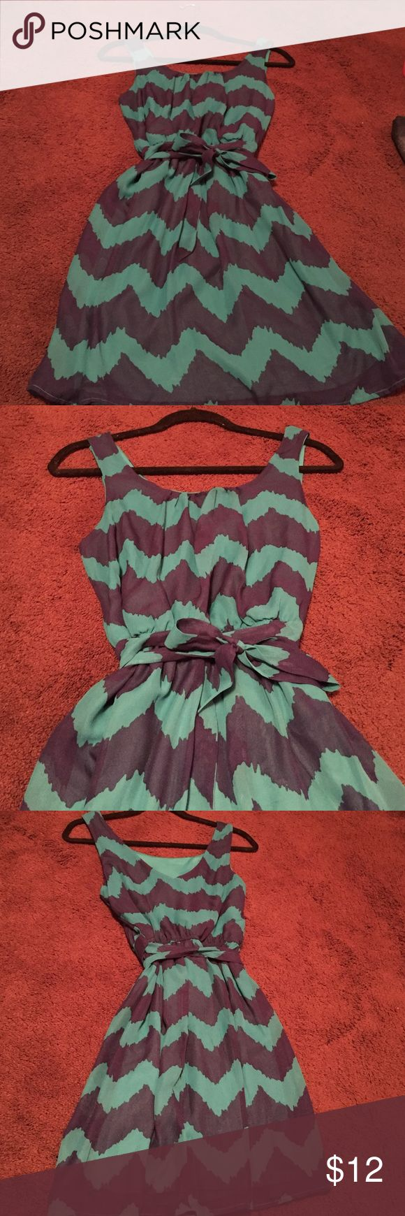 Teal and navy chevron dress Teal and chevron navy dress - in excellent condition - worn once - ties around the waste Lily Rose Dresses