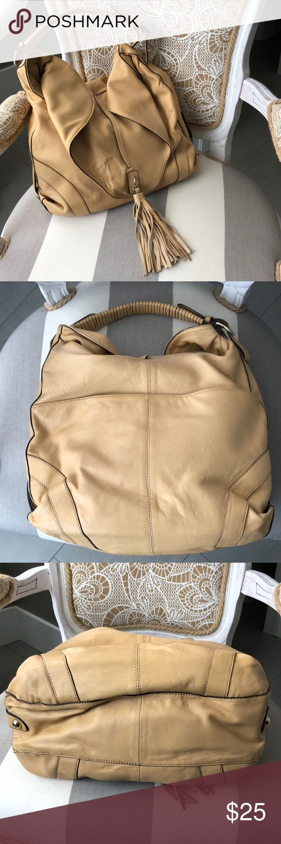 Genuine Leather Carmel Hype Hobo Beautiful genuine butter soft leather Carmel colored hobo shoulder bag. Tons of room with one side pocket that clasps, interior pockets for credit cards & cell phone and a zipper pocket. Interior is in excellent condition. Some light wear on the handle (see picture). No other marks or wear spots. Overall in very good condition. Hype Bags Hobos
