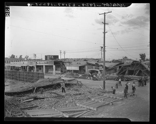Collapsed shops, shattered windows, broken telephone lines at Ninth St. after earthquake in Imperial, Calif., 1940
