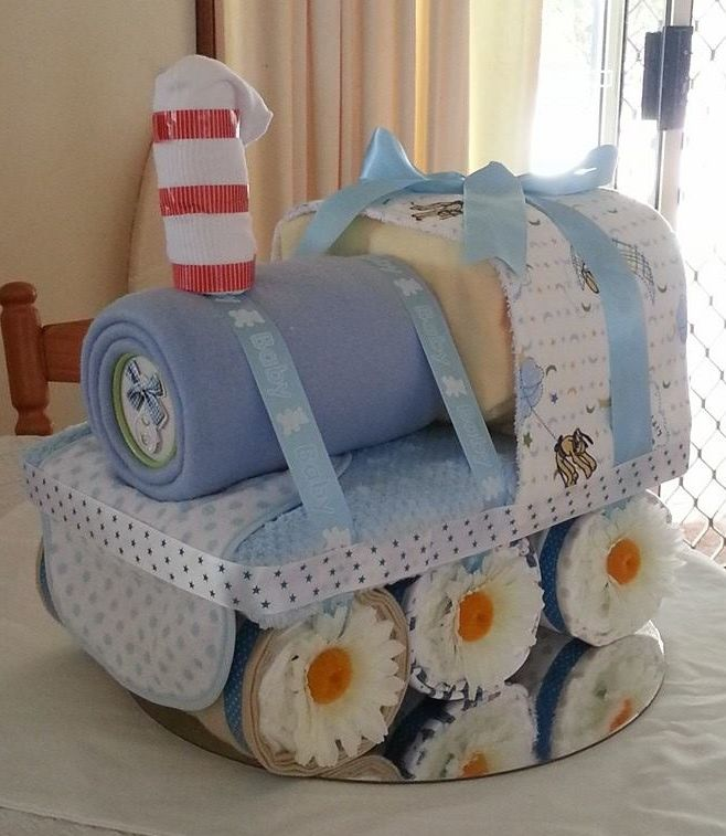 Shalea Design Toot Toot !! Nappy Train   Contains - 55 Newborn Nappies  6 x Winter Wraps  2 x Baby Boy Bibs  1 x Burp Cloth (Toweling Backed)  1 pair White Baby Socks  1 Cylinder Pack of Kleenex Tissues   $100.00   Custom Made To Order https://www.facebook.com/shaleagiftboxes?ref=hl