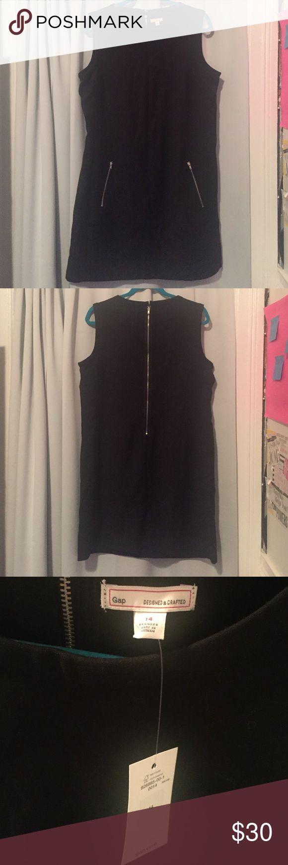 NWT GAP black shift dress with zipper pockets NWT GAP black shift dress with zipper pockets. Size 14. GAP Dresses