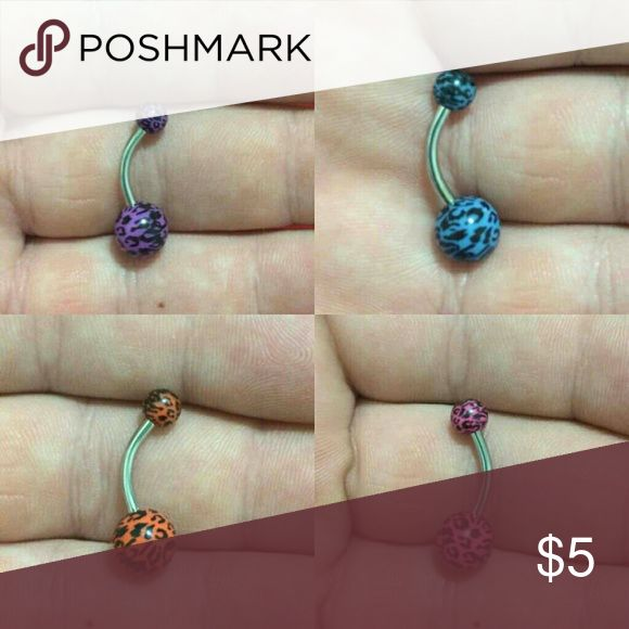 Animal print belly ring - Brand new, never worn. - 14 gauge. - Standard post length. - Acrylic ball ends. - Surgical steel post.  **ALL BODY JEWELRY IS SANITIZED BEFORE SHIPPING** Jewelry