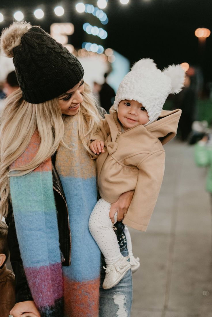 My sweet baby girl, Tatum, and I rocking this cold weather in our pompom beanies! Isn't her baby girl jacket adorable! I love the bow detail! So cute and girly! #trulydestiny #winteroutfit #babygirloutfit