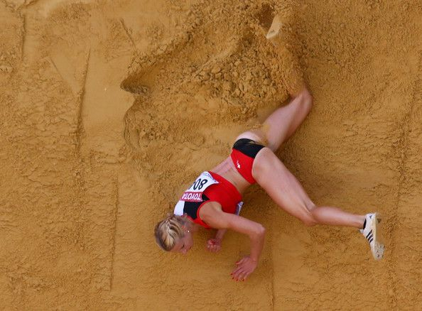 Linda Zublin of Switzerland competes in the Women's Heptathlon wearing a back kinesiology taping application. For more info on our SPORTTAPE visit: www.sporttape.co.uk