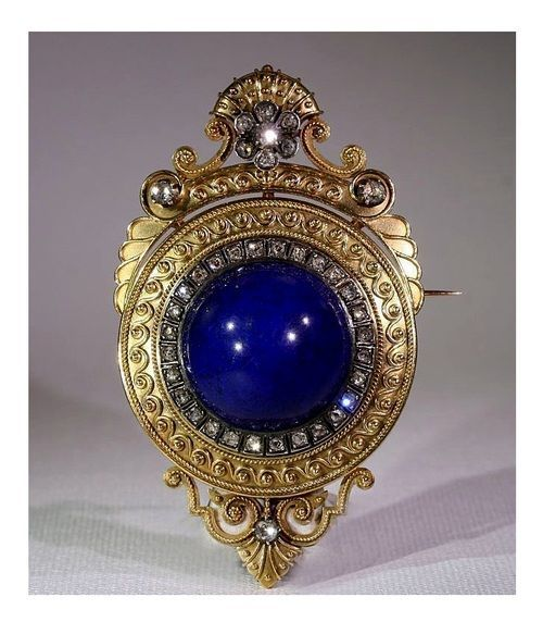 Lapis lazuli, diamond, silver and gold Etruscan revival brooch, circa 1870.