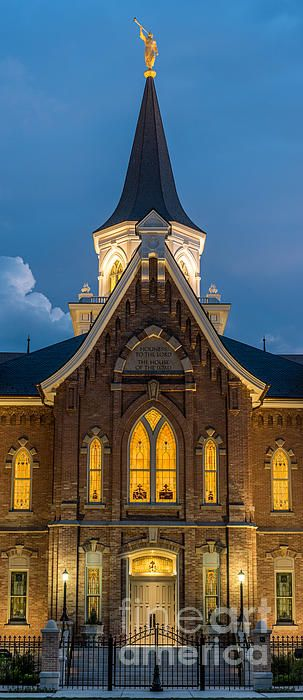 A close-up night view of the recently dedicated Provo City Center Temple, showing the interior lighting of the building and its stained glass windows, as well as the Temple's largest spire with the Angel Moroni Statue. Although the Provo City Center Temple was dedicated as the 150th LDS Temple, its history dates back to 1898, when it was constructed as the Provo Mormon Tabernacle. It was a fire that gutted all but the outer structure of the Tabernacle, that led its reconstruction, and…