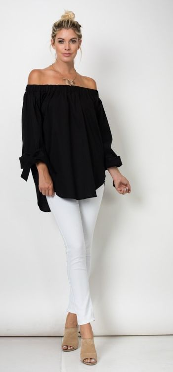 THIS IS THE MUST HAVE BLOUSE!! This top is everything! Beautiful cotton black blouse is so easy and breezy! Everyone should have a top like this in their closet! Elastic band all the way around the to