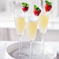 Ingredients 50ml Waitrose Pressed English Apple Juice 20ml Waitrose Elderflower Cordial Top with Valdo Oro Pure Prosecco Superiore 1 strawberry 2 fresh mint leaves on a sprig Method 1. Pour the juice and cordial into a shaker with crushed ice. Shake and double strain into a flute glass. Top up with the Prosecco. 2. Garnish with a strawberry on the rim with 2 mint leaves on the strawberry's stalk (replacing its leaves).