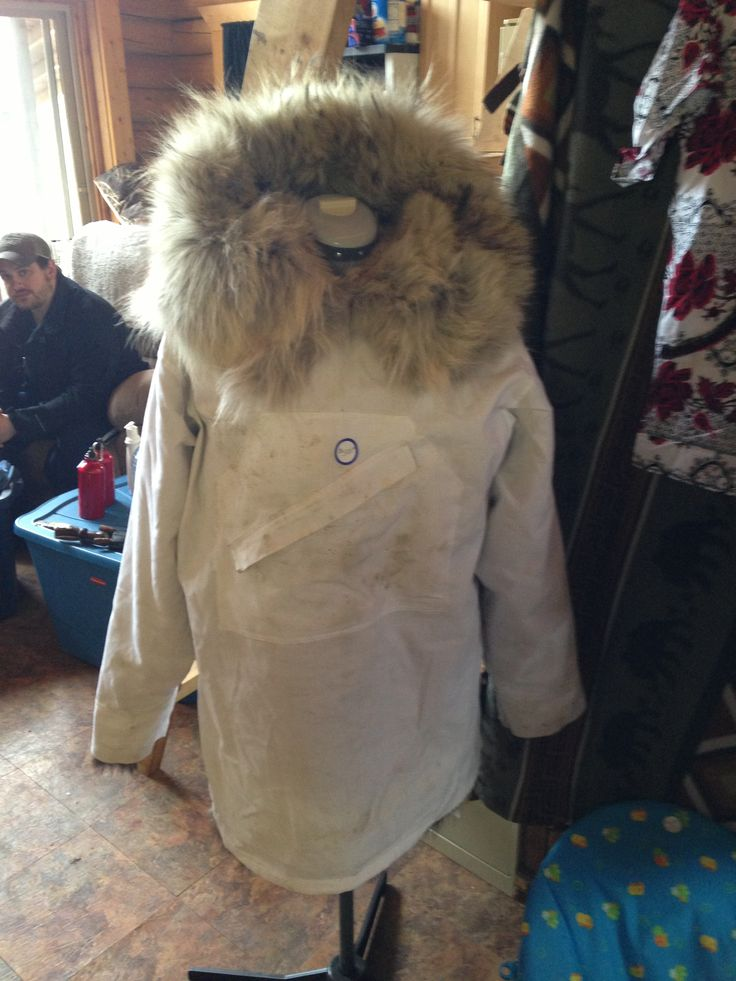 Men's Tuscany lambskin Parka. It has a wolf ruff and wolverine trim. White cover with large stomach pocket. Extremely warm!!! Size large.