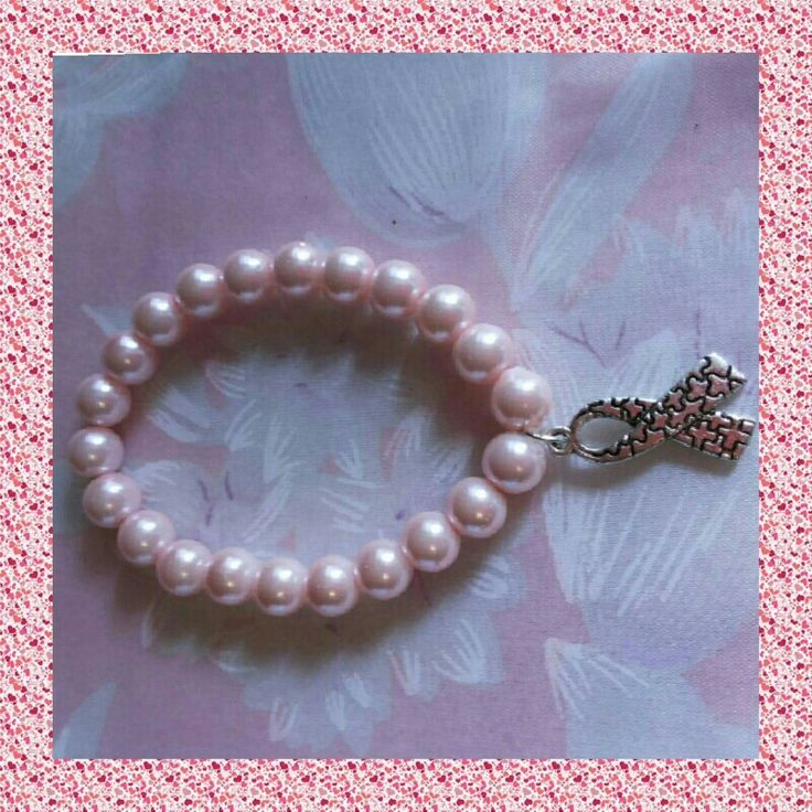 Allusive bracelet in fantasy pearl,  cure breast cancer.