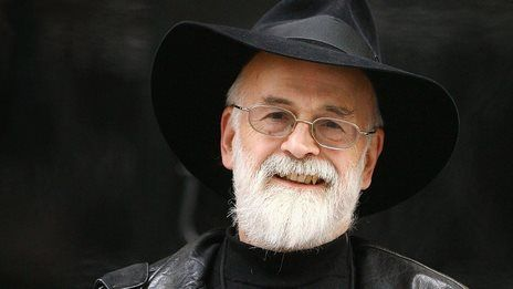 """""""AT LAST, SIR TERRY, WE MUST WALK TOGETHER.""""  Sir Terry Pratchett, renowned fantasy author, died on March 12th at the age of 66. He wrote over 70 books, including his famous Discworld series."""