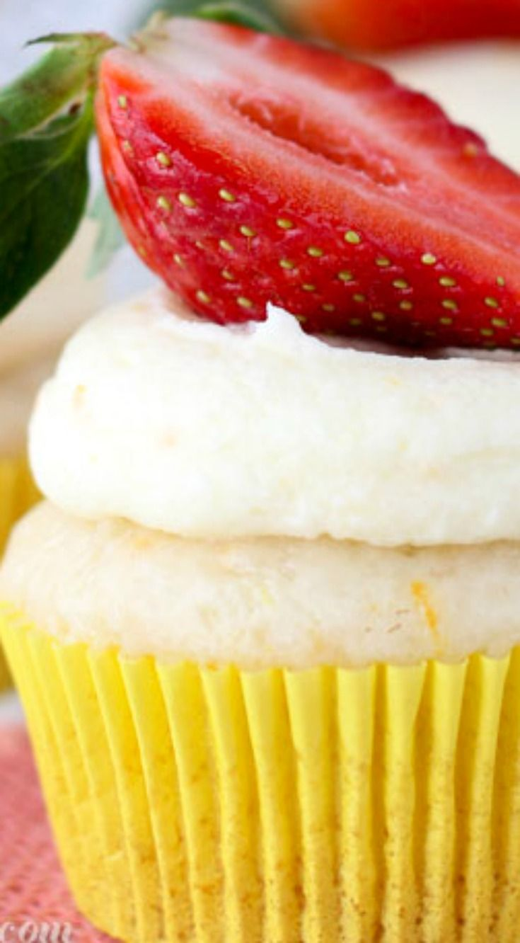 Easy Mimosa Cupcakes ~ These Mimosa cupcakes are an orange infused champagne cupcake made with a cake mix. Then they are soaked in champagne syrup and topped with an orange cream frosting.