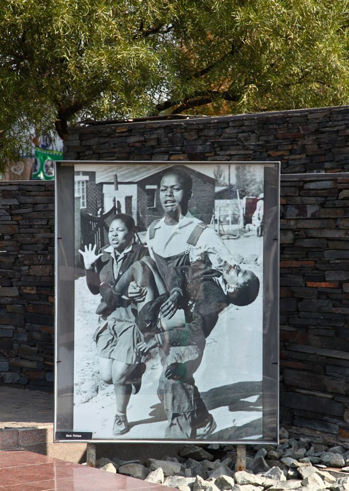 First victim of Soweto uprising. Hector Pieterson was only 13 years old when he was shot dead by South African police 16.6.1976. This photo taken by photographer Samuel Nzima became a symbol of uprising. Schoolgirl running on the left is Antoinette Sithole, sister of Hector. Memorial on the yard of Hector Pieterson Museum in Soweto, Johannesburg, South Africa. © Miikka Järvinen 2013