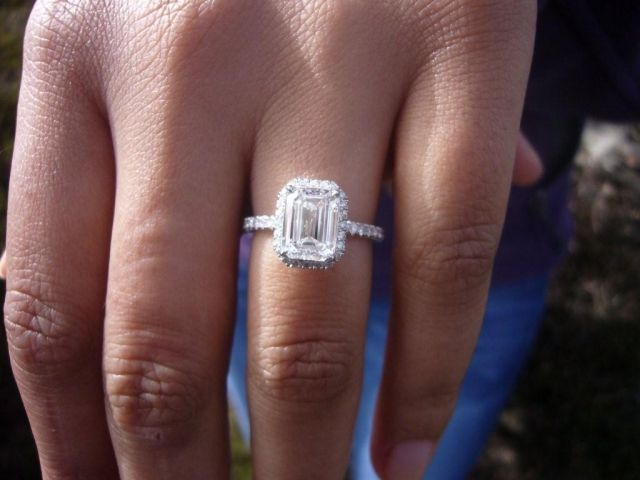 Yes yes yes. Love the contrast between the emerald cut and the smaller stones around it!
