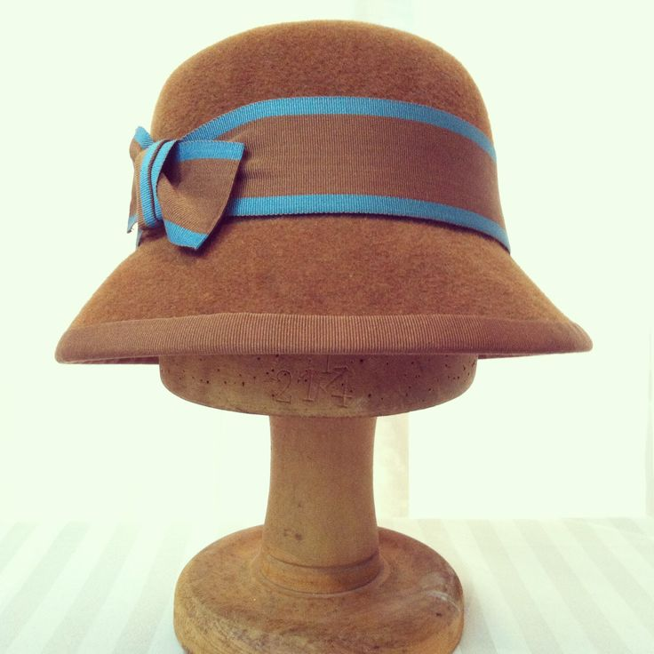 Fur felt cloche with peak brim trimmed with vintage ribbon