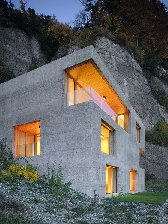 Awesome interior in wood of these concrete house. Project: Holiday house Vitznau by Lischer Partner Architekten Planer AG