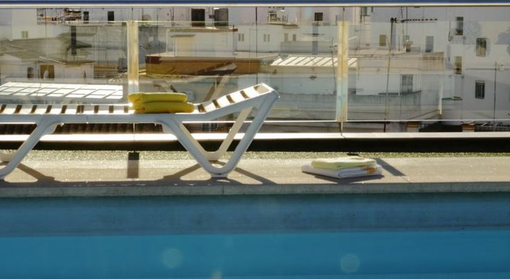 Hotel Don Paco Sevilla Hotel Don Paco is set in central Seville, 10 minutes' walk from the cathedral and Giralda Tower. It features a rooftop swimming pool and sun terrace with excellent city views.