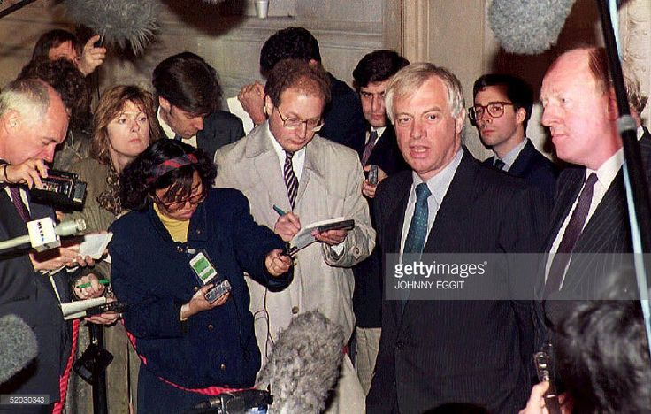 Hong Kong Governor Chris Patten (2nd R) speaks to reporters 13 April 1993 to announce that Britain and China are scheduled to resume talks on Hong Kong's future. Representatives from the two countries plan to hold talks in Peking beginning 22 April.
