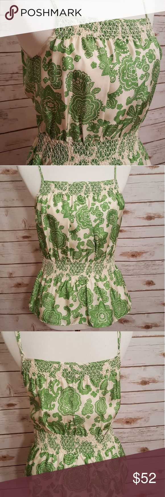 """100% silk summer top Absolutely beautiful green and white print Summer top. The smocking at the bodice and the waist is accented with an overlay of embroidery - exquisite craftsmanship. Straps are adjustable. Est 18 1/2"""" length from top of bodice to hem. 100% silk. Etcetera is a private label designer clothing company, designed in NYC and made with quality fabrics from Europe. Etcetera clothing is not sold in stores or online, it is only available for purchase through private consultants…"""