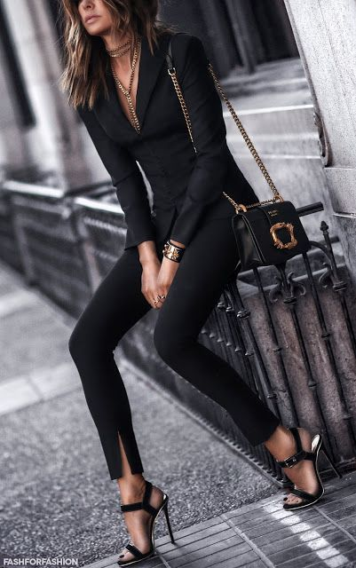 Complete black blazer and trouser outfit. Black high heel sandels and black/ gold bag