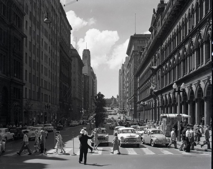 A beautiful sunny day in Sydney, 1964, on the corner of Martin Place and George Street.