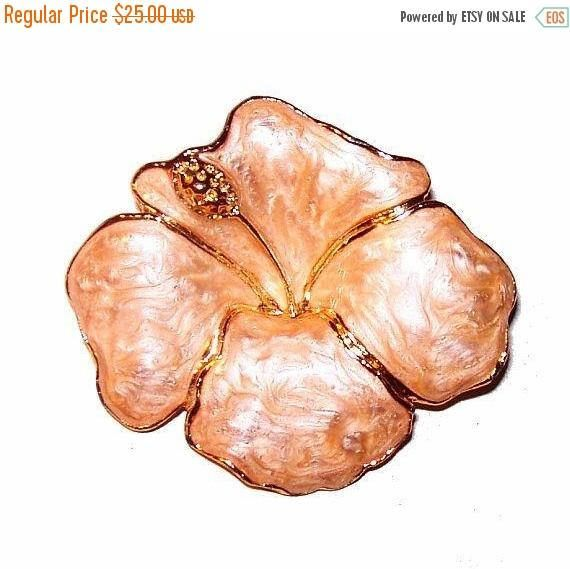 ❘❘❙❙❚❚ ON SALE ❚❚❙❙❘❘     Pink Enamel Flower Brooch Gold Metal Trim Signed 1 3/4 Vintage offered by brightgems treasures.  Pretty signed Pink Enamel Flower Brooch. The color is a light beige rose pink color with swirls and gold trim outlining the flowers petals. Its signed, but I cant make it out, reminds me of Cerrito jewelry? Brooch measures approx. 1 3/4. Dates to the 1970s-80s. High end, designer, fashion, enamel, flower, pink gold, brooch, pin. Nice for spring and summer. Very ...