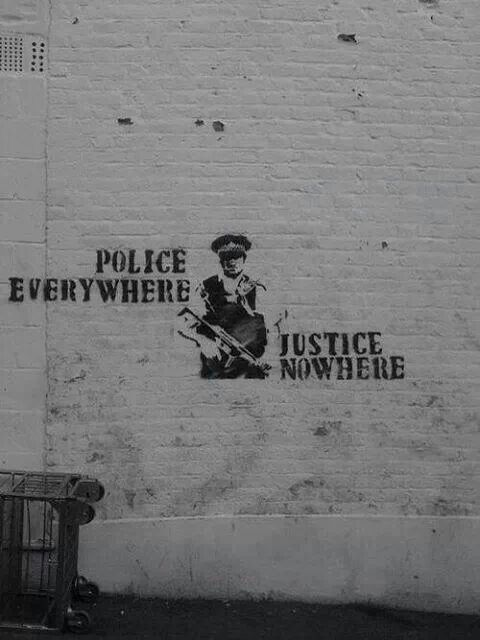 "street art ""police everywhere/justice nowhere"""