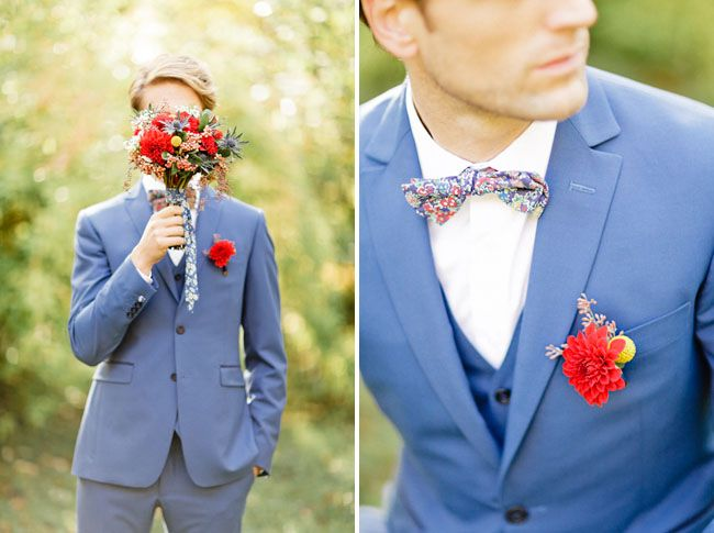 colorful bouquet and boutonniere of red chrysanthemums, blue thistle, yellow pod and babys' breath florals
