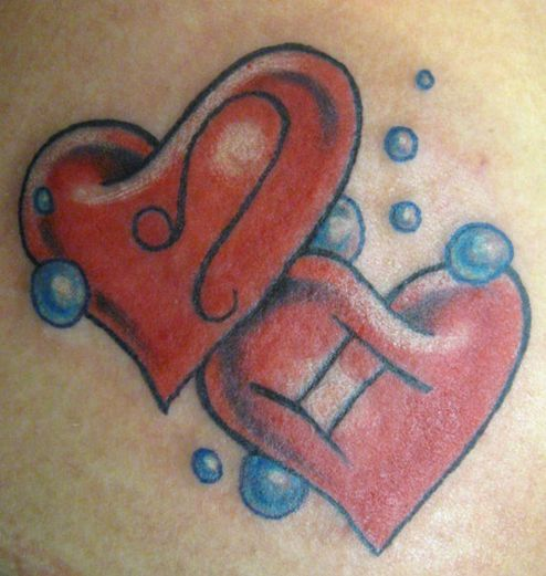 Two big hearts wrist tattoo with blue bubbles pics.JPG