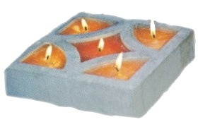 This project makes wonderful candles for your patio. If you havent already got some of these decorative pavers try your local hardware store. Place a cardboard base onto the bottom of the mold to stop the wax pouring out. Secure the edges with some plasticine to stop any leaks. Pop in your wicks and pour the wax into each section allow to cool and remove the cardboard and plasticine.