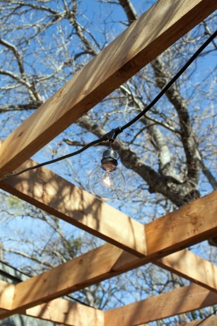 Outdoor string lights add a nice touch to the the patio pergola.