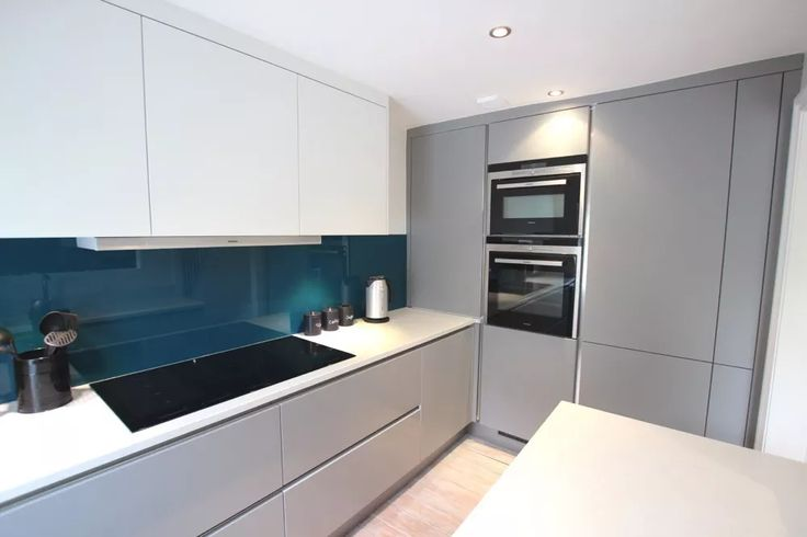 Stunning two tone kitchen design with Pearl Grey matt lacquer kitchen base and tall units, and white wall units. The handleless finish adds to the stylish and contemporary effect.