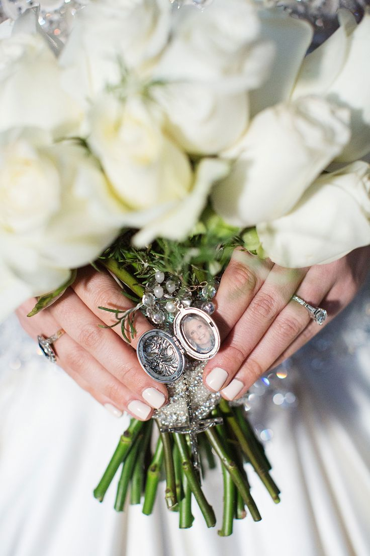 White Rose Bouquet with Locket  Photography: Sarah Kate, Photographer Read More: http://www.insideweddings.com/weddings/traditional-catholic-ceremony-festive-new-years-eve-reception/1051/