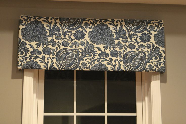 We suggest fabric valences roughly 5' over the windows in the library resembling this pattern.