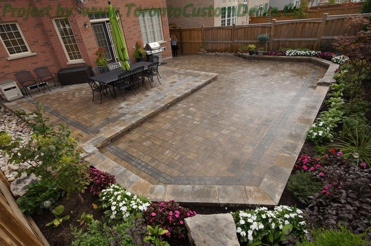 A semi hexagon shaped backyard deckdesign customdeck for Garden design ideas toronto