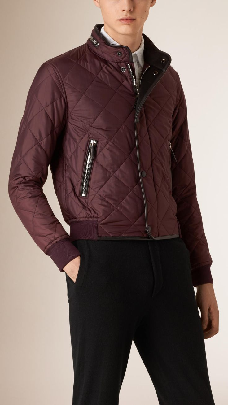 A modern bomber jacket with heritage quilting and supple lambskin binding. Knitted ribbed cuffs and a packaway hood protect against the elements.