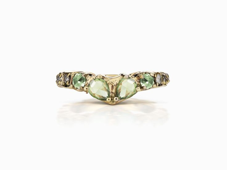 Sacred Band | 14k yellow gold green sapphire wedding band with white diamonds | 14k yellow gold wedding band with green sapphire and white diamonds and pavé setting | For the alternative bride, Maniamania Fine Jewelry offers nontraditional, vintage inspired engagement rings. With ethically sourced rose cut gemstones and diamonds, our unique bridal Fine Jewellery is handcrafted in New York #sacredband #maniamania #themaniamania #maniamaniafine