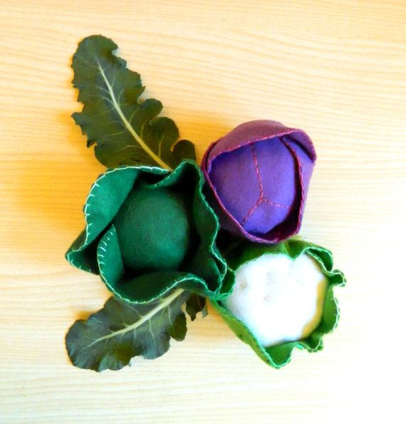Fresh felt vegetables from the winter garden: cauliflower, savoy cabbage, purple cabbage.    I hand sew the cabbages in green, white and