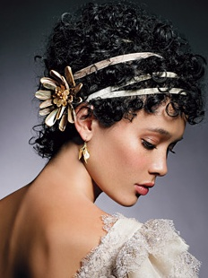 Gives the look of an updo to short Curly Hair. Too Grecian? Maybe with more tendrils down? ( these are just vague suggestions remember!)