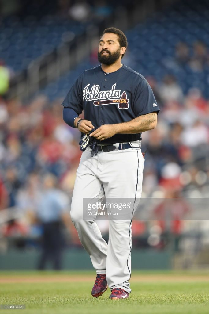 News Photo : Matt Kemp of the Atlanta Braves looks on during a...