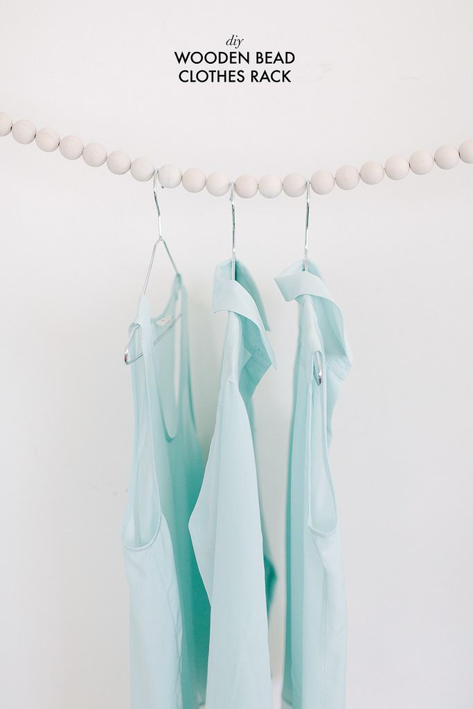 Small space? No clothes rack? Here is a truly simple, but brilliant idea to store clothes without crushing them: string beads on rope. Ta-dah!