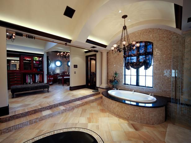 """Million Dollar Rooms: Sunken spa bath divides """"his"""" and """"hers"""" massive walk-in closets."""
