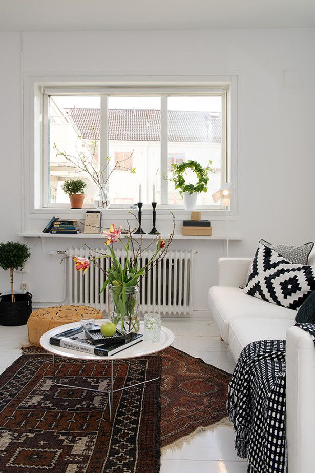 Cozy White Sofa Fresh Green Plants Black And White Geometric Patterned Cushions Brown Square Rug