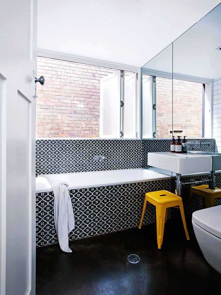 """Kathy won the battle to have a floor-to-ceiling mirrored wall in the bathroom with wall-hung basin, toilet and fittings. """"John really wanted me to tile that wall,"""" she says. """"The special glass was expensive, and it was tricky as you've got to use large pieces of mirror that are strong enough to withstand the strain of the wall-hung features without cracking."""""""