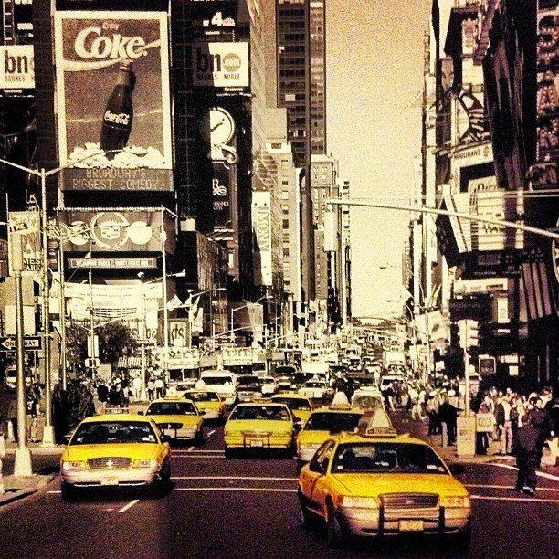Black white and yellow taxis