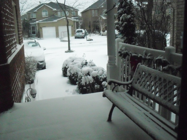 my home's front porch   1st snow storm in 2012