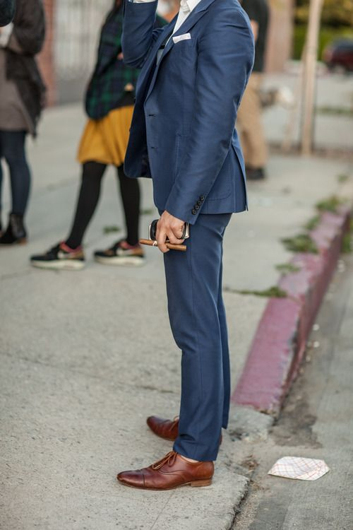 """Slim fit"" doesn't have to mean ""Austin hipster."" Keep things in proportion with sleek shoes, tapered jacket elbows and waist, and trousers that break at the top of your shoes."