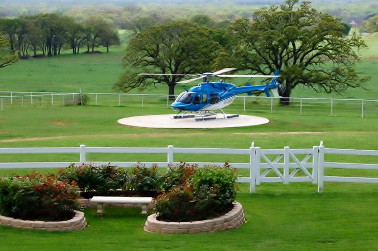 Helicopter On Helipad At Mansion Lone Star Mansion