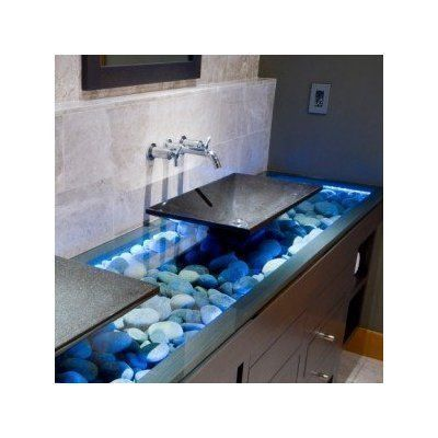 Glass sink with rock and LED lighting. easy to do with thick glass, add water on the inside with circulation and bleach for a very custom job.