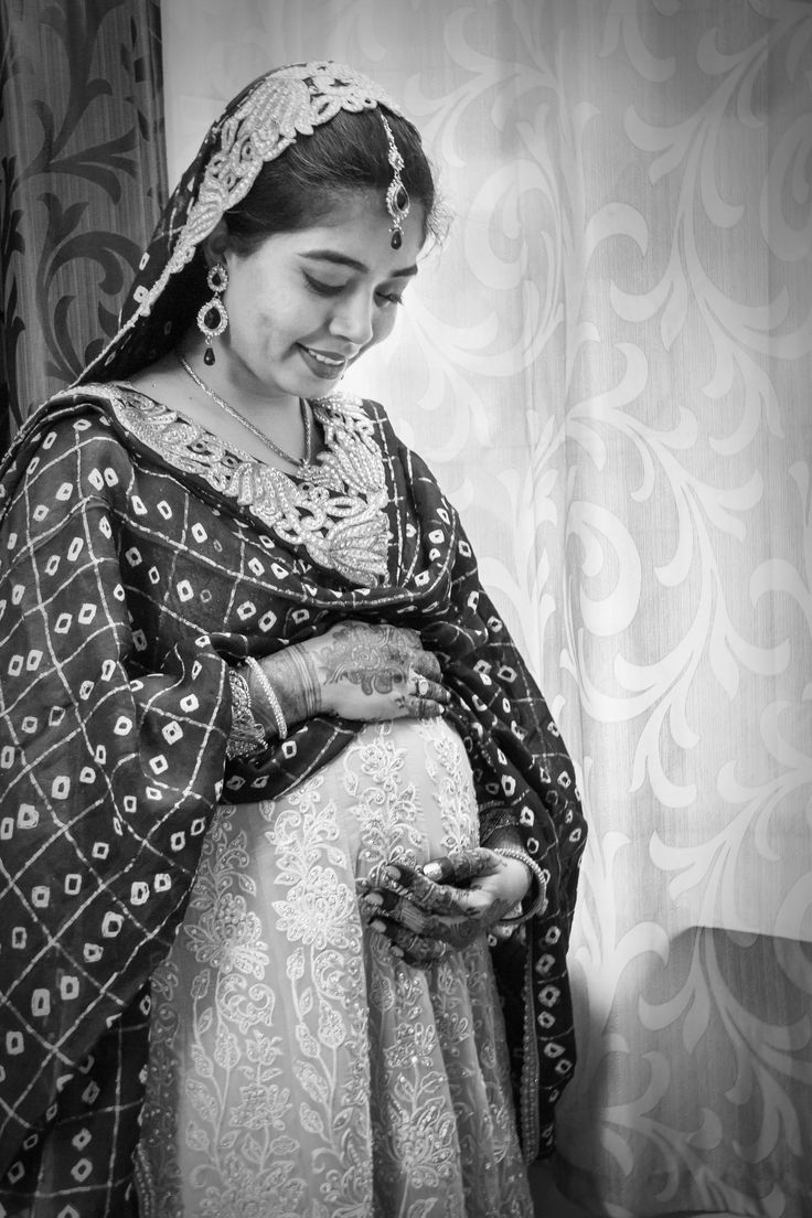 """[FAN PHOTO!] What a stunning photo! Thanks for sharing """"This photo was clicked at my baby shower (known as 'Godh Bharai' in India). This is a very special ceremony as the pregnant lady is dolled up like a bride and is blessed by all family and friends... """" *** WANT TO GET FEATURED? Email info@bellybelly.com.au WITH the subject: Fan Photo (so I don't lose them in my inbox!) and any details of the photo. Please note that we cannot credit photographers, and spam is prohibited on BellyBelly.***"""